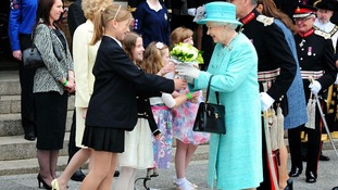 The Queen given flowers by local children at the Council House in Nottingham