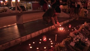The candlelight tribute grew after a few initial tea lights were placed along with flowers at the scene.