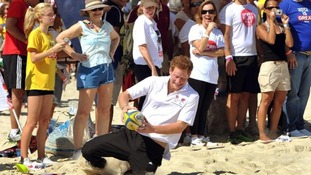 Harry scores a try as he plays touch rugby with children on Flamengo Beach
