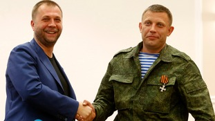 "Alexander Borodai (left), the former leader of the self-proclaimed ""Donetsk People's Republic"", shakes hands with his replacement, Alexander Zakharchenko."