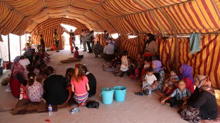 Displaced people from the minority Yazidi sect take refuge in Dohuk province.