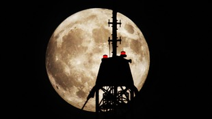 "A ""supermoon"" with a communications tower near Harthill in Scotland."