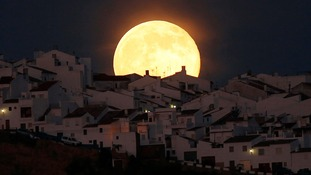 A Supermoon rises over houses in Olvera, in the southern Spanish province of Cadiz.