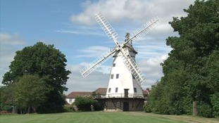 The listed windmill still stands in the town.