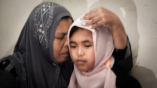 Jamaliah hugs the 14 year old believed to be her missing daughter Raudhatul Jannah.