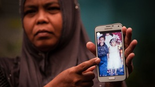 Jamaliah shows a picture of her daughter before she was swept away by the 2004 Indian Ocean tsunami.