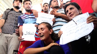 Displaced members of the Yazidi community gather during a protest against militants of the Islamic State.