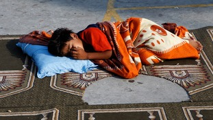 A boy sleeps in a United Nations-run school sheltering displaced Palestinians in Gaza City.