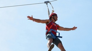 Zip wire rider in action