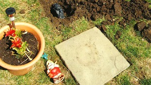 The guns were found buried under gnomes in the suburban garden.