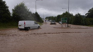 Cars battle flood waters in Louth