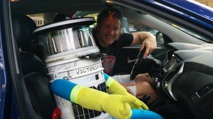 hitchBOT with some of the people who have helped him on his way so far.