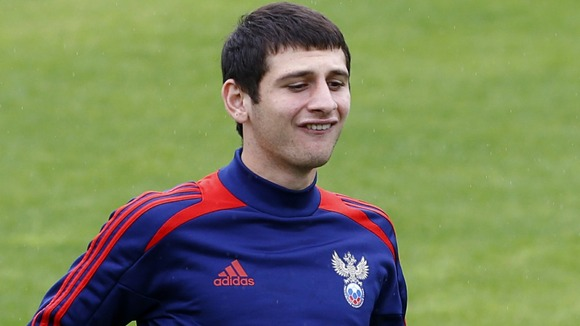 Russia's Alan Dzagoev controls the ball during a training session in Sulejowek, Poland.