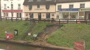 A bank has collapsed alongside the River Nene