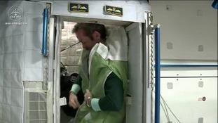 Canadian Cmdr Chris Hadfield demonstrates how astronauts sleep.