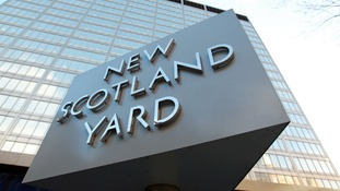 The New Scotland Yard sign outside its headquarters