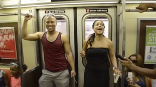 Cast members from the Broadway show sang a capella on the train.