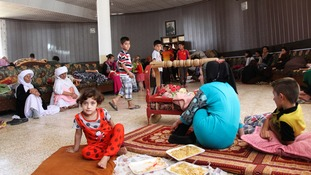Displaced Yazidis take refuge after fleeing the violence in Sinjar.