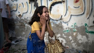 A Palestinian girl reacts at the scene of an explosion in Gaza city in July.