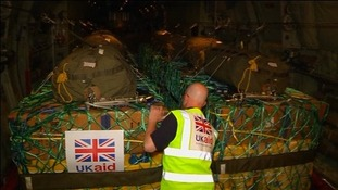 A worker checks a British aid consignment to Iraq.