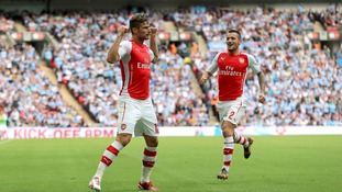 Arsenal's Olivier Giroud (left) celebrates scoring their third goal.