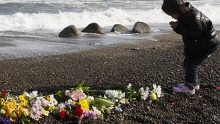 Girl prays for victims of the earthquake and tsunami in Iwaki