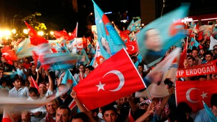 Supporters of Turkish Prime Minister Tayyip Erdogan celebrate his election as the country's 12th president in Ankara