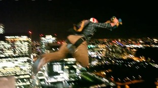 They performed the stunt from the balcony of the Attic Bar, which is on the 48th floor of the high-rise building.