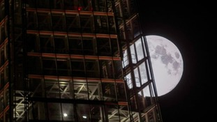 The supermoon behind The Shard