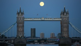 The supermoon pictured above London's Tower Bridge.
