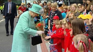 The people of Corby welcomed the Queen with an abundance of flowers and flags.