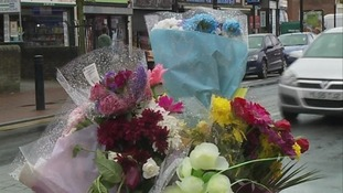 Flowers left for girl who died in bus crash.