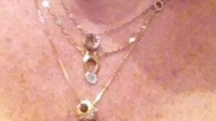 The victim's pendant necklace was stolen.