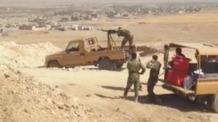 Kurdish Peshmerga look out on Quwair, about 25 miles southwest of Irbil.