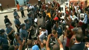 Protesters gather outside Ferguson police headquarters