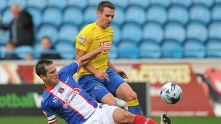 Derby's Craig Bryson battles with former-Ram Paul Thirlwell