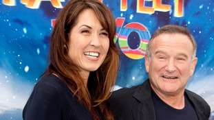 US actor Robin Williams, his wife Susan Schneider (L)