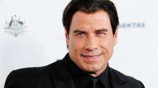 John Travolta said Robin Williams 'made us happy.'