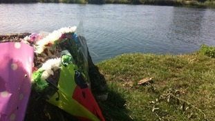 Flowers left by friends for a 15-year-old boy who drowned at the River Ouse in Hartford near Huntingdon.