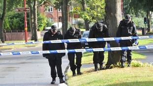 Police examining the scene