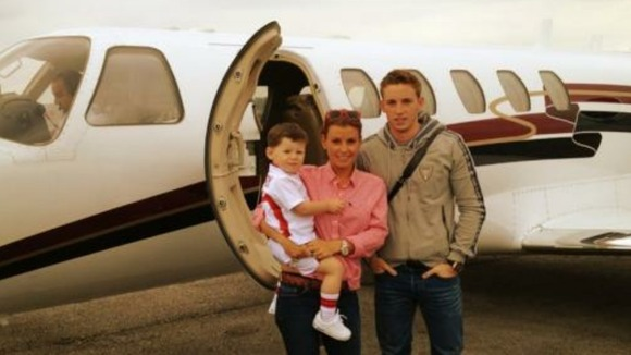 Coleen Rooney, son Kai and brother Anthony McLoughlin prepare to board a private jet to Poland.