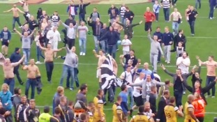 Fans invade pitch