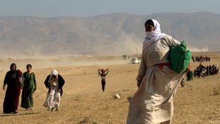 The UK has delivered aid to the mainly Yazidi refugees on Mount Sinjar.