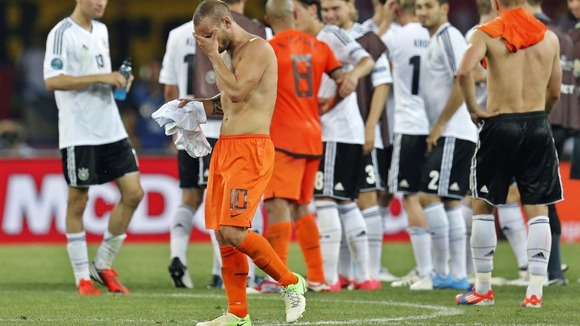 Wesley Sneijder looks dejected after the 2-1 loss to Germany.