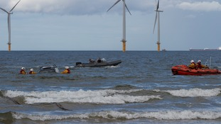 The RNI was called to two vehicles trapped by the rising tide