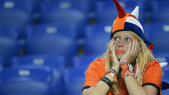 A Dutch fan looks glum after the defeat to Germany.