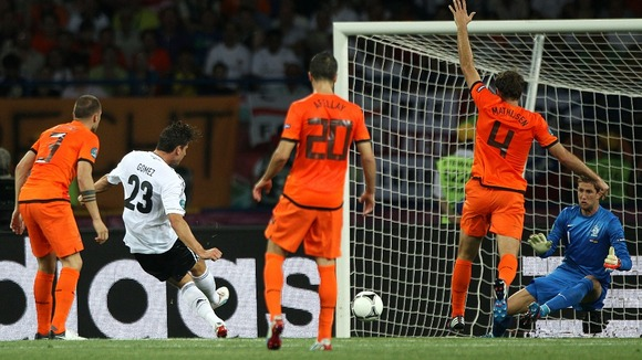 Germany striker Mario Gomez scores his first goal of the game.