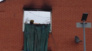 Window from which two people jumped to escape the flames
