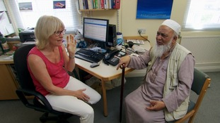 Doctor consults elderly man