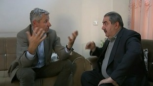 ITV News presenter Mark Austin (L) talks to former foreign minister for Iraq Hoshyar Zebari